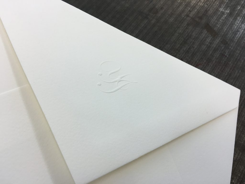 Envelopes for personal stationery with blind embossed monogram.