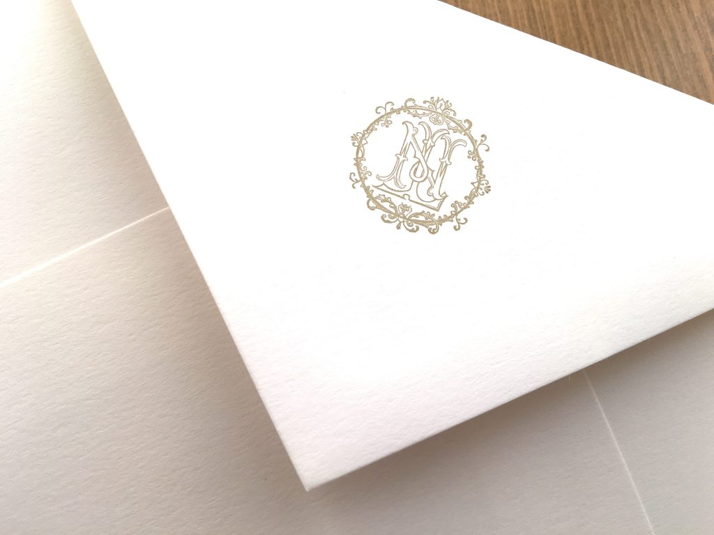 Envelopes for personal stationery with gold engraved monogram.
